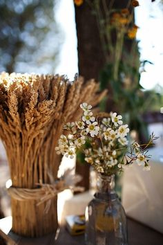 Wheat and Wax Flower go beautifully in this outdoor autumn wedding.