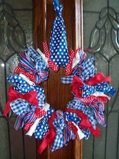 Red, White, & Blue: With some ribbon or scraps of fabric you can create this perfect wreath for your 4th of July party.