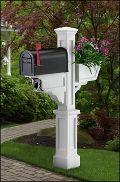 Making the world a better place, one pretty mailbox at a time.  Seriously people, have some self-respect for your yard!
