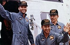 Apollo 13 astronauts (L-R) John Swigert, James Lovell, and Fred Haise are shown soon after their rescue still unshaven and wearing space overalls, aboard the USS Iwo Jima (1970)