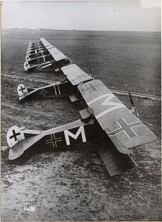 """Karl Menckhoff's Fokker D.VII of Jasta 72 (marked with prominent letter """"M""""s) at Bergnicourt, July 1918.  Menckhoff was credited with 39 confirmed victories. Already in his 30s when he learned to fly, he was one of the oldest pilots in the Imperial German Air Service. He won the Pour le Mérite (""""Blue Max""""), and was given a squadron command. Menckhoff became a prisoner of war, along with many other German pilots, at Camp Montoire, near Orléans."""