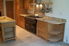 Classic oak kitchen units, with cooker and island. Love the baskets in the island, great idea!
