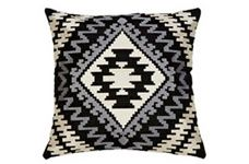 Aztec Cushion  The Aztec cushion is the Style 13 solution to the tribal and geometric trend taking over fashion and interiors. With a classic colour palette and a timeless embroidered design against a black base, this cushion will work perfectly against any bright or neutral backgrounds.