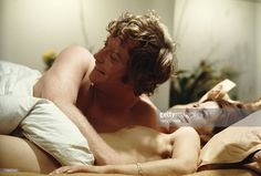 English actors Michael Caine and Geraldine Moffat act out a sex scene for the film 'Get Carter', 1970.