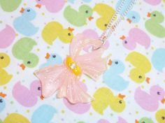 All Wrapped Up  Pink Sparkly Bow Necklace by NiNEFRUiTSPiE on Etsy, £1.50