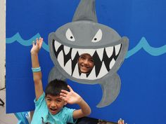 Photo booth I made for Max's Shark Birthday Party. I bought a blue cardboard trifold from Michael's for $5 and painted this in about an hour. Another great idea I found on pinterest!