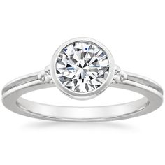 This ring showcases a dazzling diamond in a bezel setting