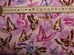 Pink sommerfugle på Patchworkstof - er et super flot stykke patchwork stof med masser af sommerfugle