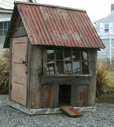 I love the rustic look of this chicken coup. Also, how fun would a secret door be on a playhouse. Lastly, love the star shutters on the house in the background! Raising Backyard Chickens, Backyard Chicken Coops, Chicken Coop Plans, Building A Chicken Coop, Diy Chicken Coop, Building A Shed, Chicken Feeders, Rustic Greenhouses, Chicken Coup