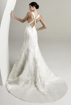 Criss Cross Straps on this low back wedding dress by Kitty Chen - Magnolia