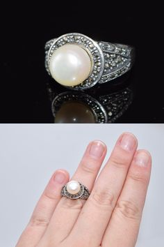 This lovely ring is made of solid sterling silver. The ring has beauty filagree open work design, marcasite, and a large pearl.   Size 8  Weight Aprox 6.2 Grams   Pearl is aprox 10mm  Hallmarked 925FD