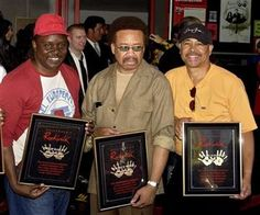 (AP Photo/Matt Sayles, File). FILE - In this July 7, 2003 file photo, Philip Bailey, from left, Maurice White, and Ralph Johnson, of Earth Wind & Fire hold up the plaques from their induction at the Hollywood Rock Walk at a ceremony in Los Angeles....