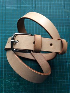 Natural veg-tan leather bespoke belt.
