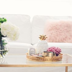 gold and white coffee table styling