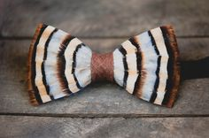 Show off your outdoorsman aesthetic with the Chuka bow tie from Brackish. With wispy browns and a natural blue-grey highlight, this piece will give your attire a rugged look. Groomsmen Gifts Unique, Groomsman Gifts, Groomsman Attire, Bluish Gray, Grey And Beige, Lapel Flower, Rugged Look, Classic Man, Bow Ties
