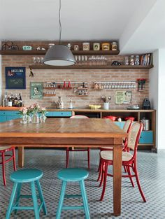 Eclectic kitchen with dining space and exposed brick wall