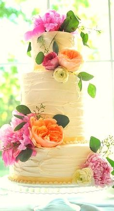 A Three-tier Wedding Cake, designed with floral icing roses, flowers, and petals, beautiful!
