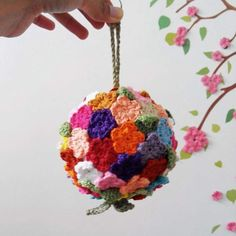 Make this flower ball using crochet mini flower appliques. Click on the picture to get to the listing. I have made one, now it's your turn.