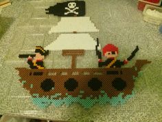 Perler bead pirate ship from a cross stitch pattern for my grandson's bedroom - by Sandy Nelms