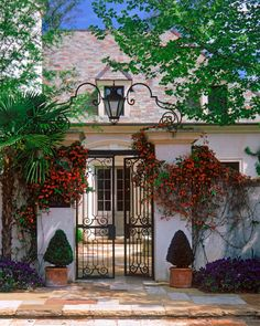 Ken Tate - Architect - Covington - French Country - Home Exterior - Neutrals - Floral - Flower - Vines - Palm Tree - Plants - Brick Floor - Lantern - Front Gate - Curvilinear - Front Door Front Gates, Entrance Gates, Design Exterior, Interior And Exterior, Front Courtyard, Wrought Iron Gates, Garden Gates, Elegant Homes, Spanish Style