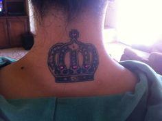 My moms crown tattoo with rhinestone dermal peircings