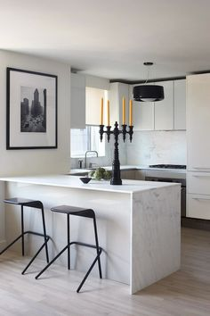 Magdalena Keck Interior Design: Modern white kitchen with sleek white modern cabinets with marble countertops and slab ...