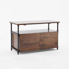 Storage Furniture - A nod to the industrial, the Pipe Short Console is made with solid mango wood and features an iron pipe frame.