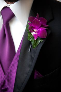 Bright purple tie and vest wedding attire with matching boutonniere, photo by Adam Nyholt