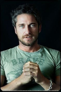Gerard Butler. After MANY looks to select just the right pic of him I guess I'll go with this one. One of my favorite shinys =)