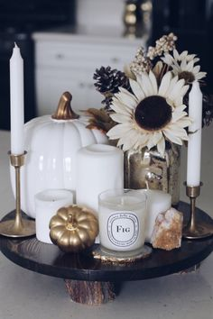 Such a pretty way to style a tray for a coffee table. Pumpkin + candles + flowers.