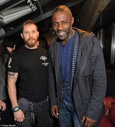 Old chums! Tom - who has a seven-year-old son called Louis from a previous relationship - posed for a snap at the Triumph launch with his Rocknrolla co-star Idris Elba