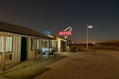 Image: A midnight motorist pulls up to the Four Aces Motel, which is nothing more than a Hollywood movie set in the Mojave Desert near Lake ...