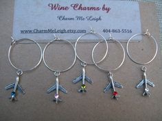 Hey, I found this really awesome Etsy listing at http://www.etsy.com/listing/122560667/airplane-plane-wine-glass-charms-for-the