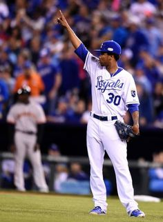 Kansas City Royals starting pitcher Yordano Ventura (30) points to Kansas City Royals center fielder Lorenzo Cain (6) after Lorenzo made a play in centerfield during the first inning during Tuesday's Kansas City Royals and San Francisco Giants Game 6 of the World Series at Kauffman Stadium on Oct. 28, 2014 in Kansas City, Missouri.