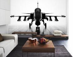 What you decorate your home with speaks volumes about you. What better way to tell the woman of your dreams that you're a heat seeking mega destroyer than with a fighter jet mural. A black and white photo mural of a moody and magnificent black jet fighter on a damp runway.