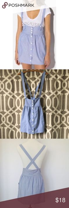 Urban Renewal Blue Chambray Suspender Skirt This is a reposh. I bought this hoping it would fit me but it's way too tight   I wouldn't consider this a medium, more like a small or extra small, in my opinion. There isn't much stretch to the material. It measures 19 in long from top of skirt to bottom, 15 in across the waist and 14 in suspender length at last button. Made from vintage fabrics. Pockets! Two different suspender lengths. Wear suspenders  criss crossed or straight. Some fraying by…