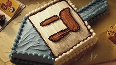 Create a dreidel-shaped cake reminiscent of the dreidel (top) used in the traditional Hanukkah game.