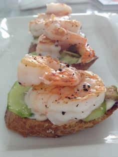 Tapas: Grilled shrimps, parmesan mayonnaise and pickled cucumbers