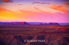 """Buttes and Swirls"""" An incredible sunrise vista awaits at Muley Point in SW Utah. Taken from a plateau high above Monument Valley where layers of erosion and time coalesce into a wondrous land with the suns rays cascading over ridge lines and mesas."""