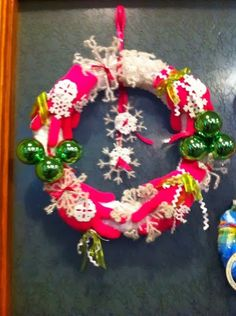 Staff wreath competition for charity. Vote for your favorite at www.facebook.com/villagepantrycatering