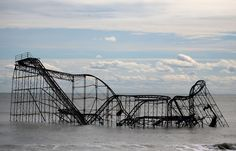 The roller coaster in Seaside Heights, NJ sitting in The Atlantic Ocean has become iconic of the damage Hurricane Sandy inflicted on The Jersey Shore. Abandoned Mansions, Abandoned Buildings, Abandoned Places, Abandoned Castles, Abandoned Theme Parks, Abandoned Amusement Parks, Abandoned Water Parks, Most Haunted, Haunted Places