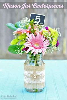 Love the mason jar with burlap/lace for the centerpieces with a nice flower arrangement
