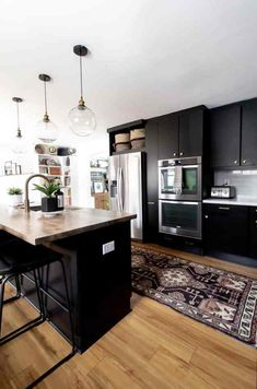 Black Kitchen Cabinets Black Kitchen Cabinets, Upper Cabinets, Painting Kitchen Cabinets, Black Kitchens, Gray Cabinets, Kitchen Countertops, Purbeck Stone, Cabinet Paint Colors, Kitchen Paint Colors