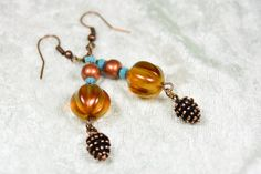 You'll be pretty as a pinecone wearing these playful copper drop earrings. $15 at #SmallestPlanet on #Etsy. Get 15% off your entire purchase with coupon code PIN15.