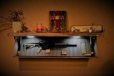 Do you want to keep your guns safe from kids and thieves? Do you want to keep your guns nearby in case you need to use them? Find the best gun concealment furniture and safes Secret Gun Storage, Hidden Gun Storage, Diy Storage, Storage Ideas, Weapon Storage, Safe Storage, Storage Baskets, Furniture Plans, Cool Furniture