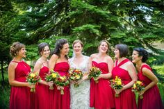 Color us red....this maids are striking in the perfect shade of red  #brideside #realwedding #wedding #red #dresses #gown #bridesmaids #fashion #style  Vintage lace and wildflowers completed this Montana wedding | Brideside