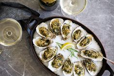 """This dish was created at Antoinette's in New Orleans as an American alternative to the French classic, escargot - or """"baked snails"""". Oysters Rockefeller are oysters on the half shell topped with spinach and a butter sauce."""