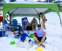 Beach tips for kids - prevent dehydration and sunburn by protecting your kids from the sun while playing at the beach not only with rash guards but a large beach canopy for all day shade. #beachfunforkids #beachtipsforkids