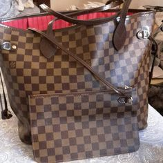 Beautiful Louis Vuitton Neverfull Replica! This bag is a must-have! I bought this as a graduation gift to myself but never got around to using. Sorry- no dustbag. This is not an authentic LV, however, it is a bag that speaks quality and is almost mirror image. See for yourself! Louis Vuitton Bags