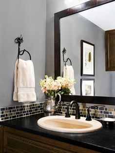 Just a small band of glass tile is a pretty AND cost-effective backsplash for a bathroom. Want to do in my master bath! New Selections: Minas Black soapstone, slate backsplash